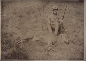 Shikari (a hunter) with a rifle and dead deer.