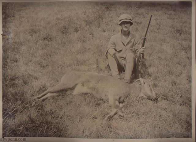 Hunter (possibly Edgar Penn) with rifle